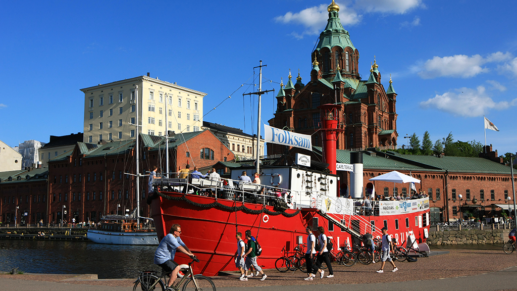 Finland's oldest lighthouse ship is moored below the Uspenski Orthodox Cathedral.